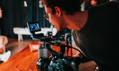 Younger filmmaker on set