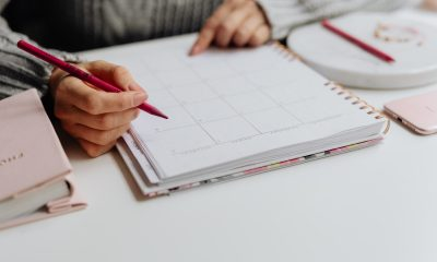 Woman making notes on a calendar to create content later