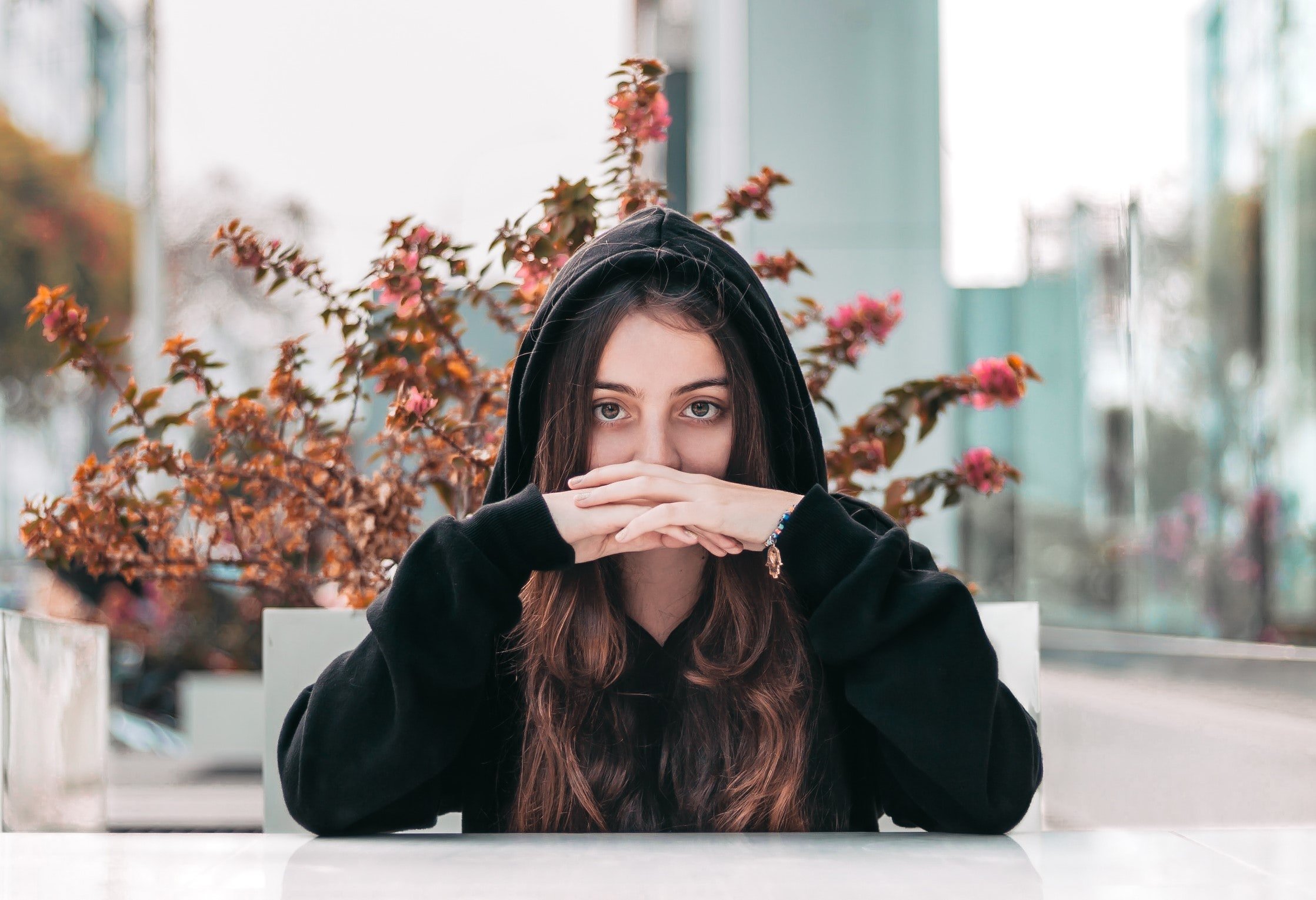 Woman covering her face partially with her hands