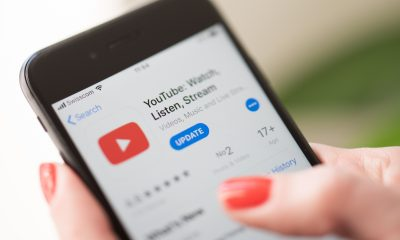 Woman using Youtube on her mobile phone